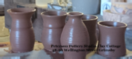 freshly thrown pots